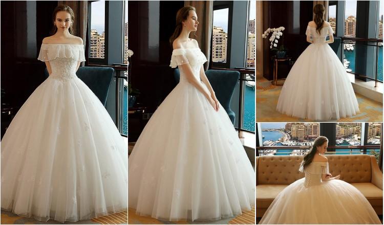 robe de mariée princesse épaule dénudé orné de bijoux